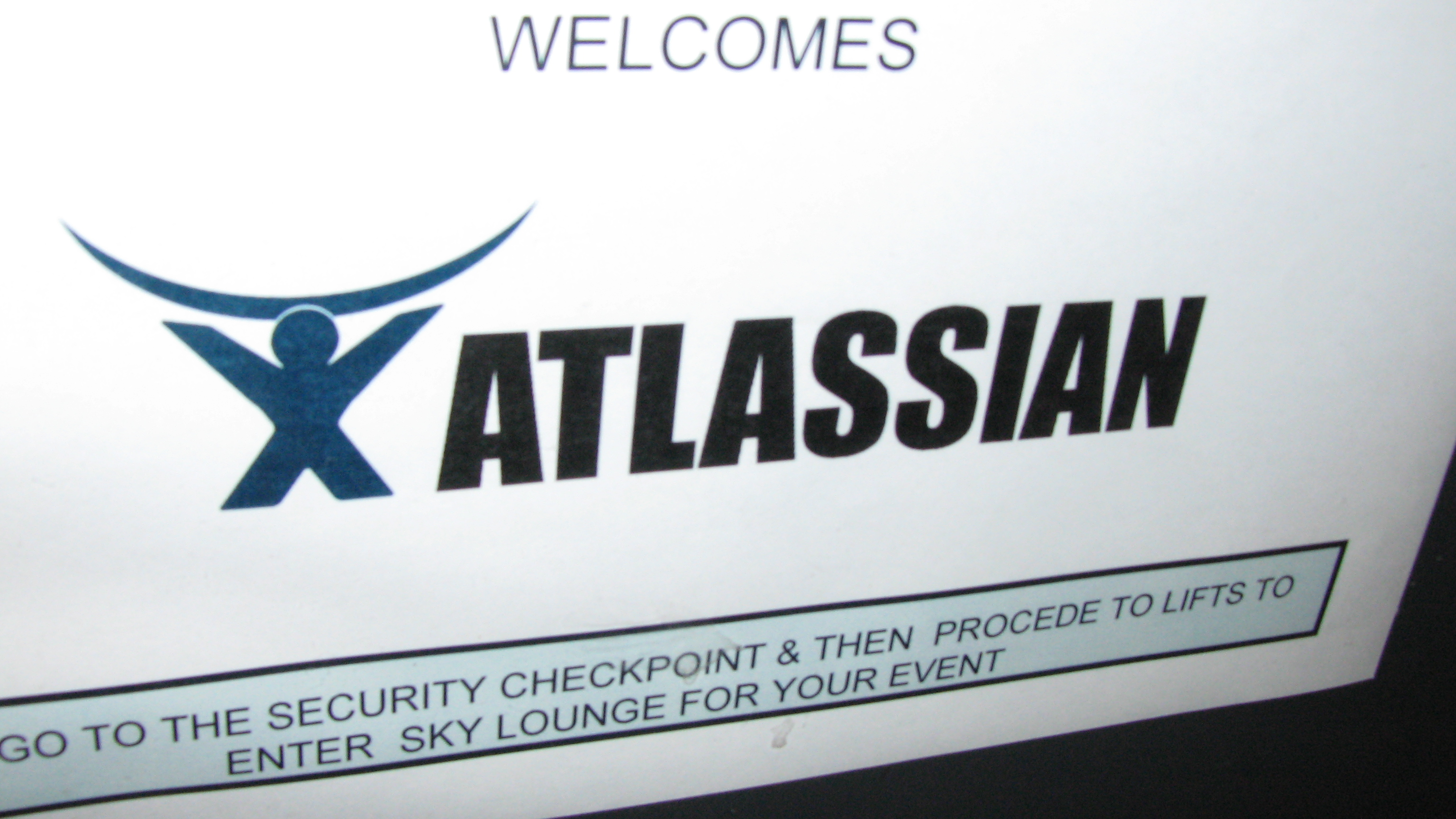 image of an Atlassian event -- CC image by Dmitry Baranovskiy -> https://www.flickr.com/photos/dmitry-baranovskiy/